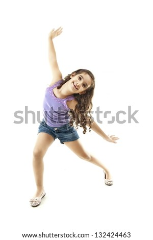 Happy child smiling with arms in the air