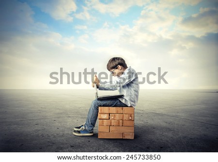 Happy child using a pc  - stock photo