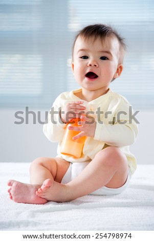 Happy child with baby food - stock photo