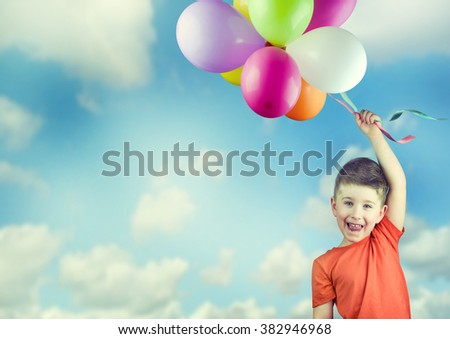 Happy child with balloons. - stock photo