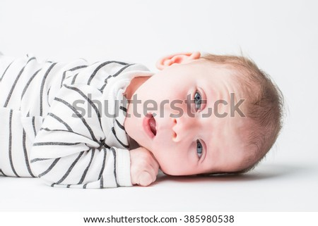 Happy child with blue eyes, isolated over white - stock photo