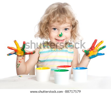 Happy child with fingers paint - stock photo