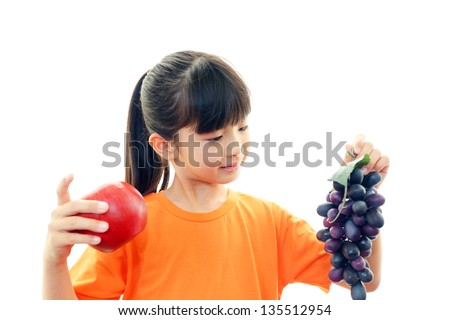 Happy child with fruits - stock photo