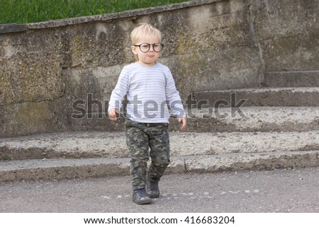 Happy child with  glasses having fun, outdoors