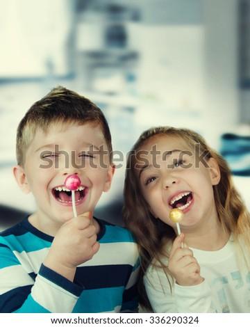 Happy child with lollipop.  - stock photo