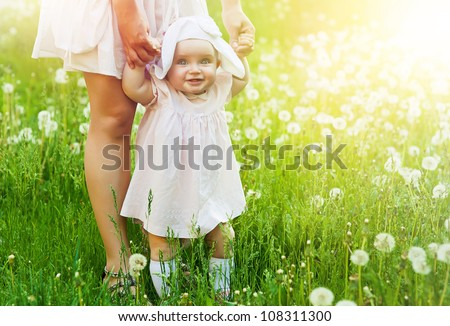 happy child with mother on the field - stock photo