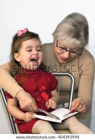 Happy child with my grandmother - stock photo