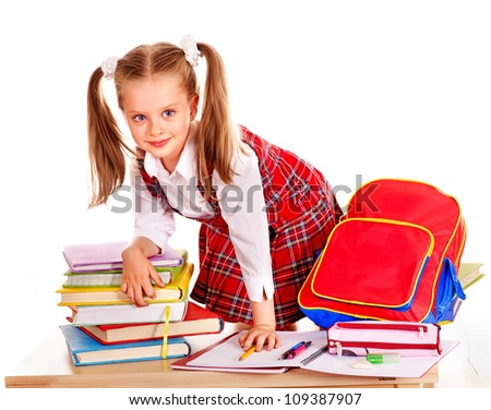 Happy child with school supplies and book. Isolated.