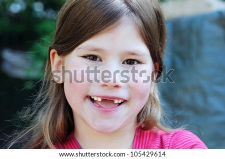 happy child with smile and changing teeth - stock photo
