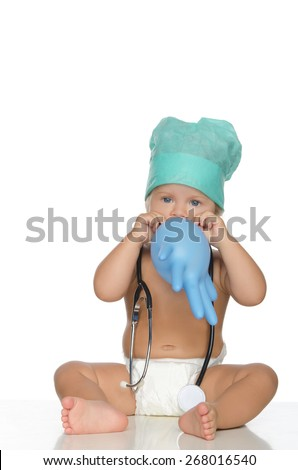 happy child with stethoscope inflate glove isolated on white. - stock photo