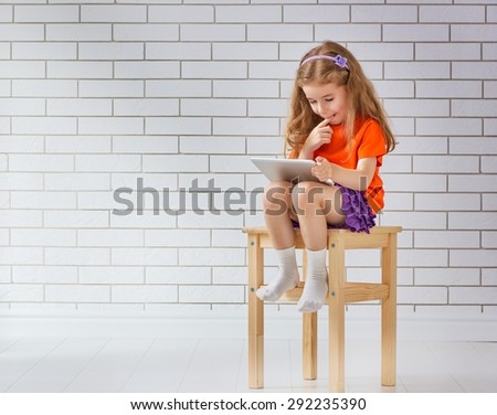 happy child with tablet computer - stock photo