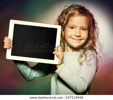 Happy child with tablet computer. Kid showing  - stock photo