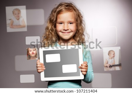 Happy child with tablet computer. Kid showing tablet screen - stock photo