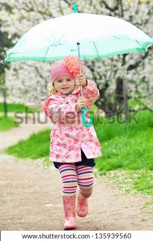 Happy child with umbrella - stock photo