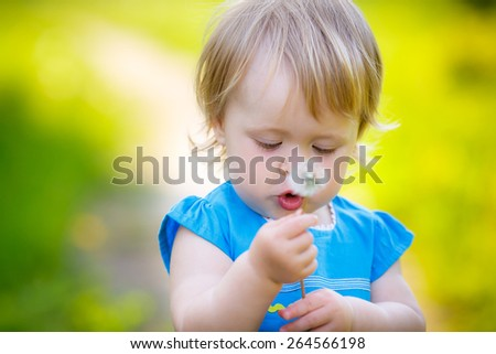 happy child with white dandelion - stock photo