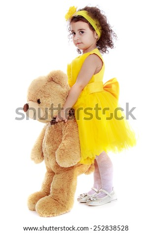 Happy childhood, the family concept.Caucasian beautiful little girl with a bear in his hands.Isolated on white. - stock photo