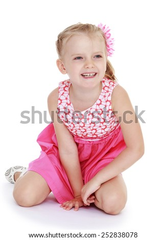 Happy childhood, the family concept.Cheerful caucasian woman in a summer dress.Isolated on white. - stock photo