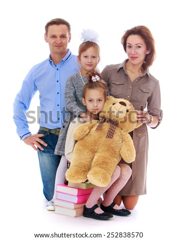 Happy childhood, the family concept.Portrait of young parents who will soon bring their children to school. Isolated on white. - stock photo