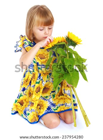 Happy childhood, the joy of fellowship, fun pastime concept.cute little girl with a sunflower.Isolated on white background. - stock photo