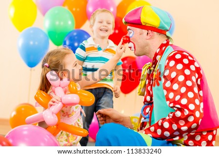 happy children and clown on birthday party - stock photo