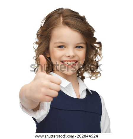 happy children and gestures concept - picture of beautiful pre-teen girl showing thumbs up - stock photo