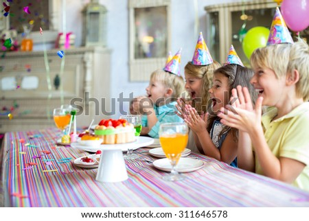 Happy children at a birthday party - stock photo