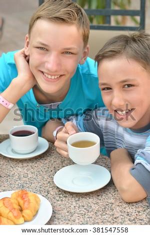 Happy children  at breakfast on tropical resort - stock photo