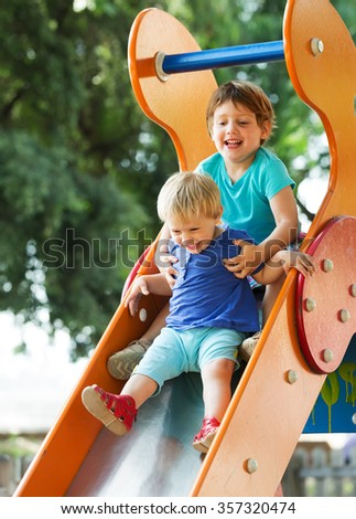 happy children at playground area  in summer - stock photo