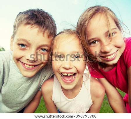 Happy children at summer. Girl and boy outdoors - stock photo