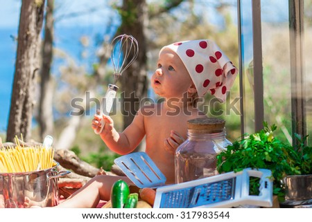 Happy children cook. Funny kids playing outdoors. Summer vacation concept - stock photo