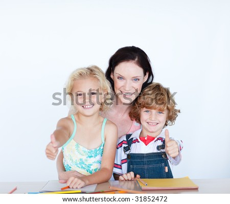 Happy children doing homework with their mother with thumbs up