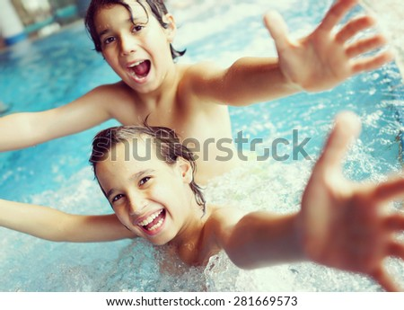 Happy children enjoying relaxing and splashing in water