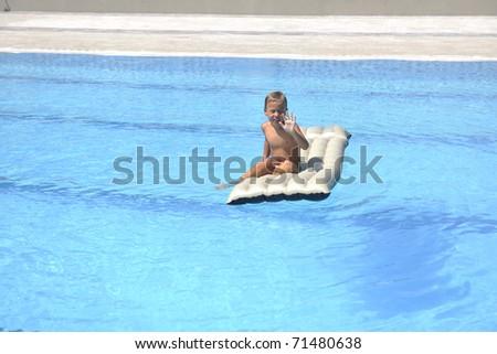 happy children  have fun on swimming pool - stock photo