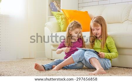 happy children holding digital tablet - stock photo