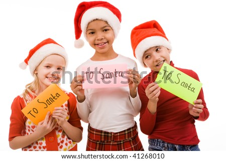 Happy children holding small papers with note ?To Santa?