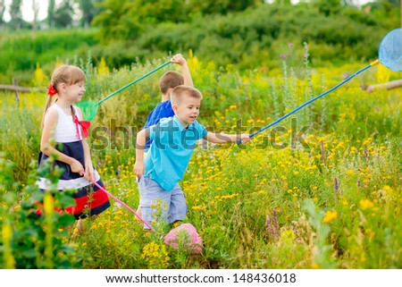 happy children in a clearing with nets