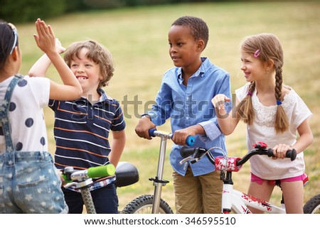 Happy Children in a team making a high five sign  - stock photo