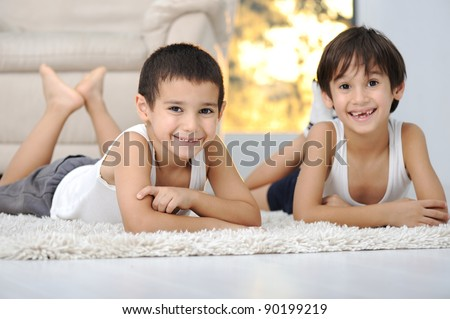 Happy children in living room at home - stock photo