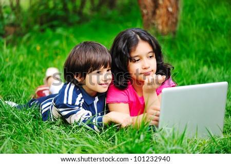 happy children in nature outdoor - stock photo
