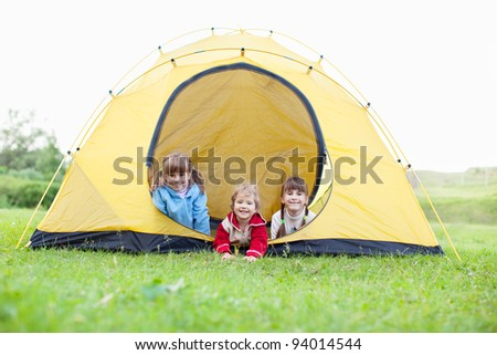 Happy children in tent. Family outdoors