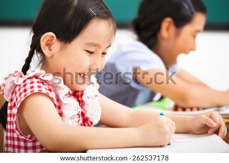 happy children in the classroom - stock photo