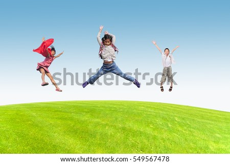 Happy children jumping outdoors