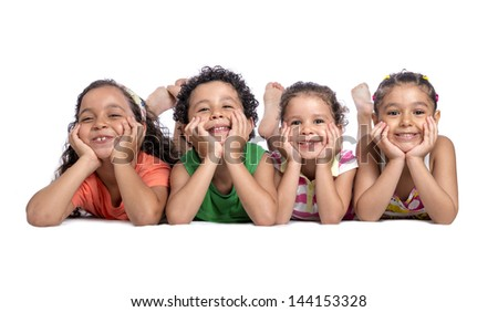 Happy Children Laying on the Floor Posing for Photo - stock photo