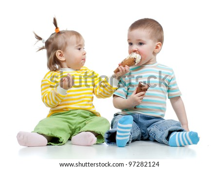 happy children little girl and boy with ice cream in studio isolated