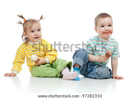 happy children little girl and boy with ice cream in studio isolated - stock photo