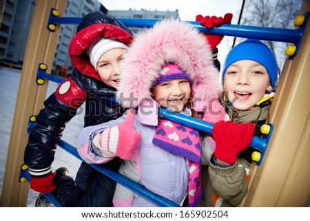 Happy children looking at camera in winter