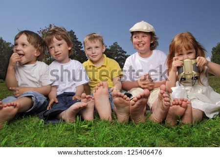 happy children on grass outdoors