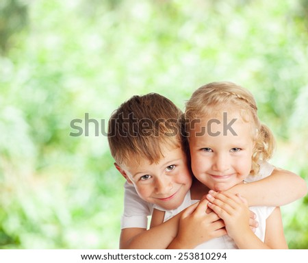Happy children outdoors. Boy and girl in summer