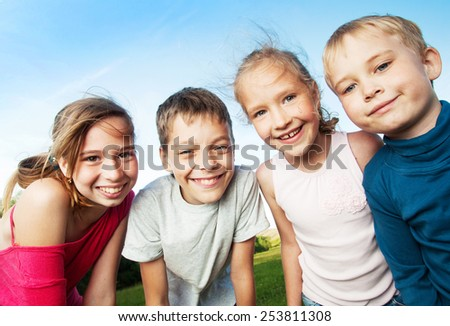 Happy children outdoors. Friends at summer - stock photo