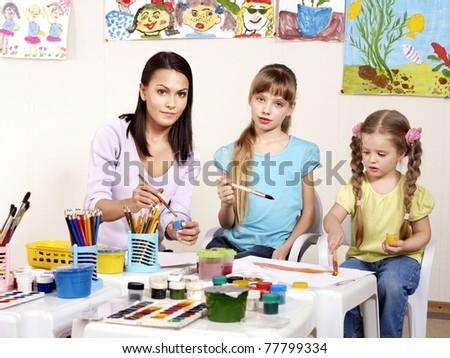 Happy children painting in preschool. - stock photo